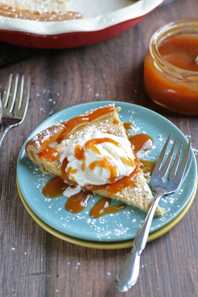 An easy, mix-everything-in-your-blender, dairy-free dutch baby made with rich vanilla bean, nutritious einkorn flour, and topped with homemade peach butter.