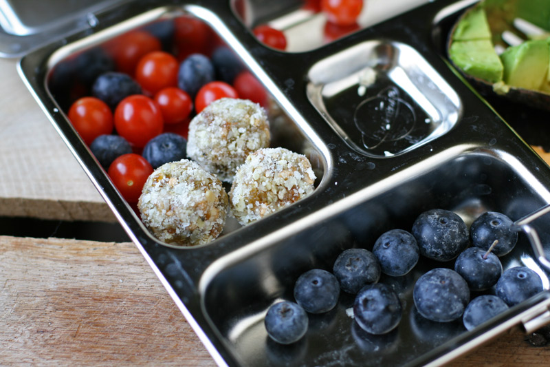 These nut-free trail mix poppers are great for little fingers to snack on or for packing in a school lunch! They're quick and easy to make, too.